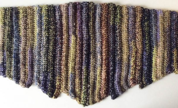 Free crochet pattern: Hug for a Long Commute scarf or shawl in Universal Yarn Classic Shades Frenzy by Underground Crafter | shawl flat lay detail