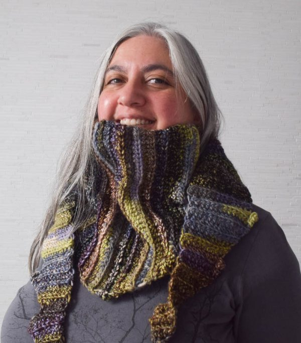 Free crochet pattern: Hug for a Long Commute scarf or shawl in Universal Yarn Classic Shades Frenzy by Underground Crafter | smiling woman wearing scarf