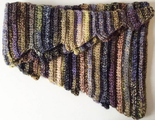 Free crochet pattern: Hug for a Long Commute scarf or shawl in Universal Yarn Classic Shades Frenzy by Underground Crafter | flat lay of folded scarf