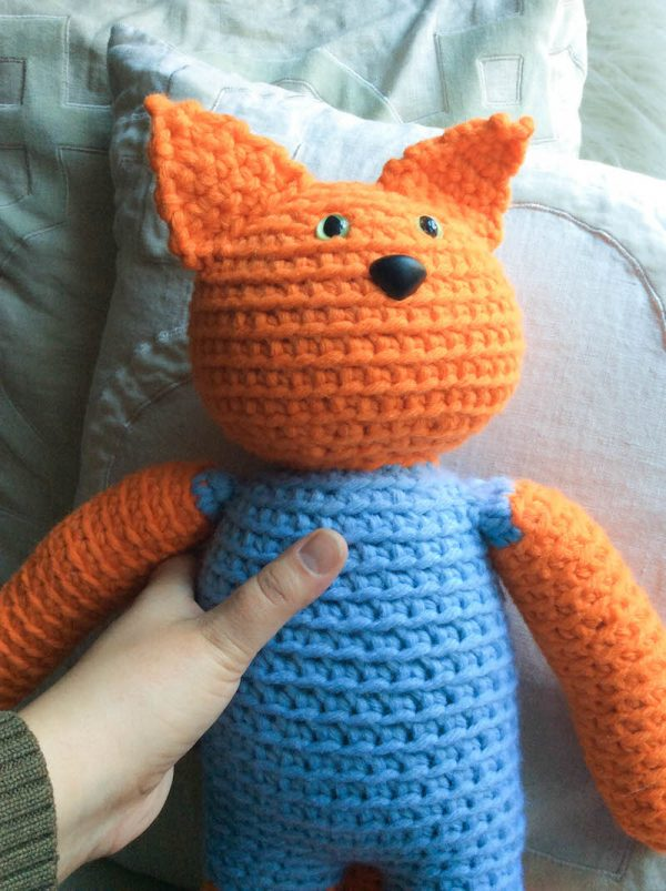 Free crochet pattern: Kitty in a Romper in Paintbox Yarns Wool Mix Chunky yarn stuffed with Fairfield Poly-Fil Royal Silk Fiber Fill by Underground Crafter - cat amigurumi in hand