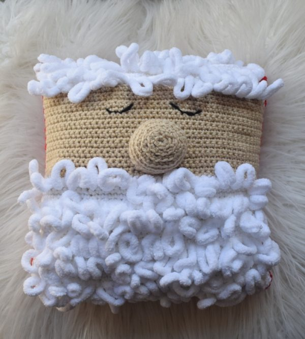Free crochet pattern: Sleepy Santa Pillow in Red Heart Super Saver and Loop-It yarns with Fairfield World Crafter's Choice Pillow by Underground Crafter | pillow on faux fur background