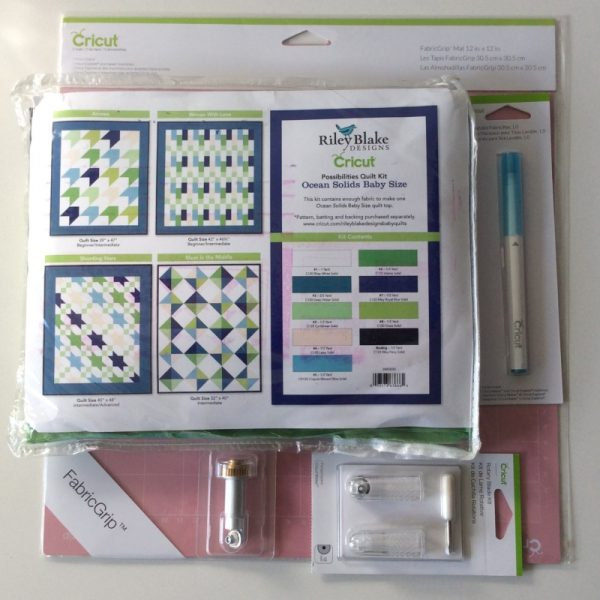 Get To Know the Cricut Maker Rotary Blade with Pillow Sneak Peek on Underground Crafter | flat lay of fabric, cutting mat, rotary blade, and washable marker