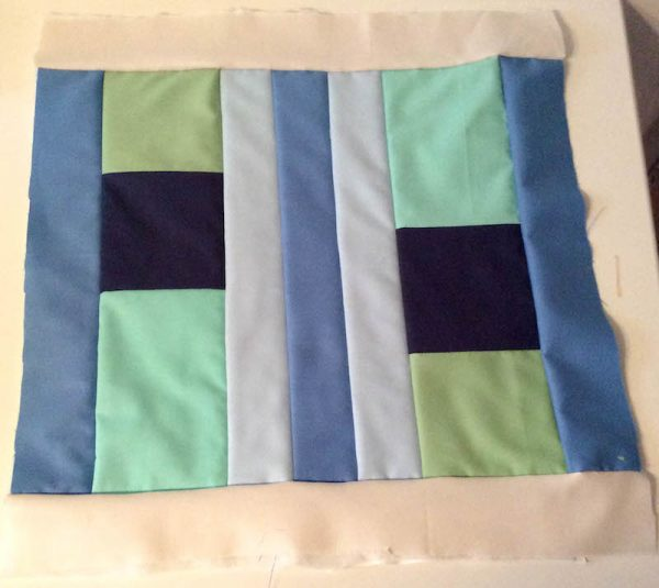Modern Quilt Pillow with Cricut Maker Rotary Blade tutorial by Underground Crafter | quilted front of pillow