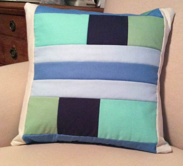 Modern Quilt Pillow with Cricut Maker Rotary Blade tutorial by Underground Crafter | pillow on couch