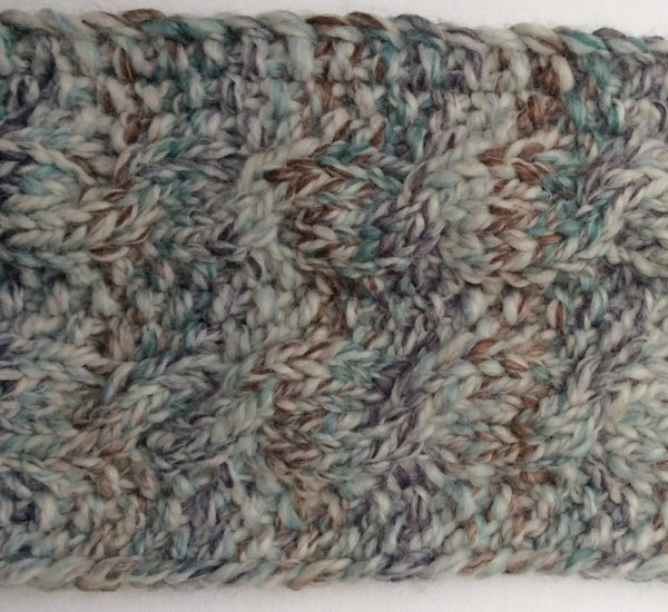 Free knitting pattern: Seeds and Cables Scarf in Lion Brand Wool-Ease Thick and Quick Bonus Bundle yarn by Underground Crafter   Flat lay of scarf