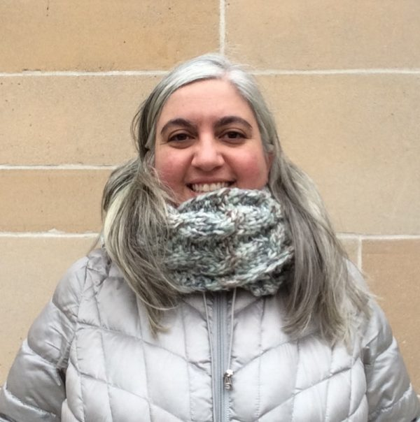 Free knitting pattern: Seeds and Cables Scarf in Lion Brand Wool-Ease Thick and Quick Bonus Bundle yarn by Underground Crafter   Scarf as infinity scarf on smiling woman