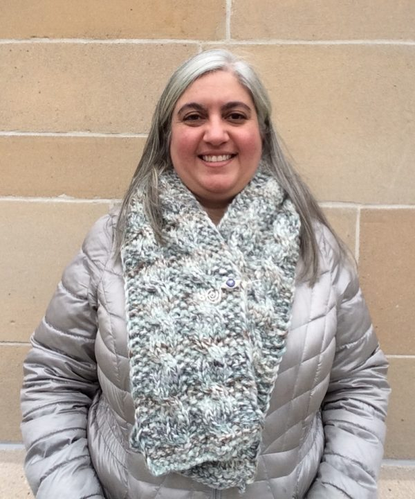 Free knitting pattern: Seeds and Cables Scarf in Lion Brand Wool-Ease Thick and Quick Bonus Bundle yarn by Underground Crafter | Scarf with shawl pin on smiling woman