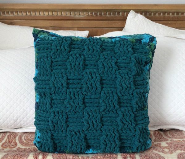 Twin Textures Pillow, free crochet pattern in Red Heart Sweet Home yarn by Underground Crafter | Basketweave side of pillow on bed