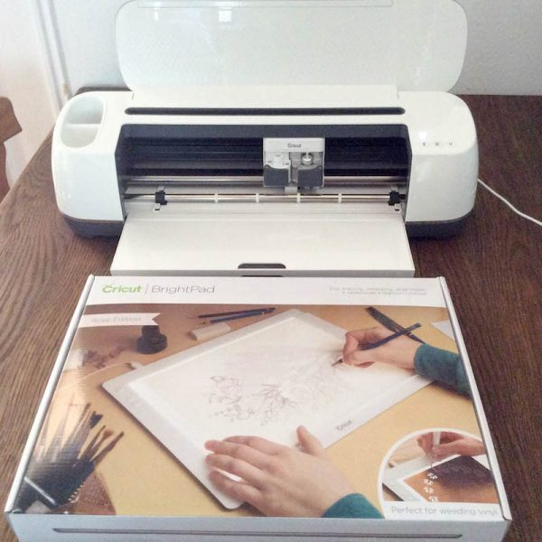 Cricut Basics: Get To Know the Cricut BrightPad with 9 BrightPad Projects via Underground Crafter | Cricut Maker with Cricut BrightPad box