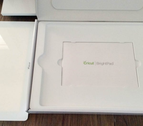 Cricut Basics: Get To Know the Cricut BrightPad with 9 BrightPad Projects via Underground Crafter | Cricut Maker with Cricut BrightPad and box