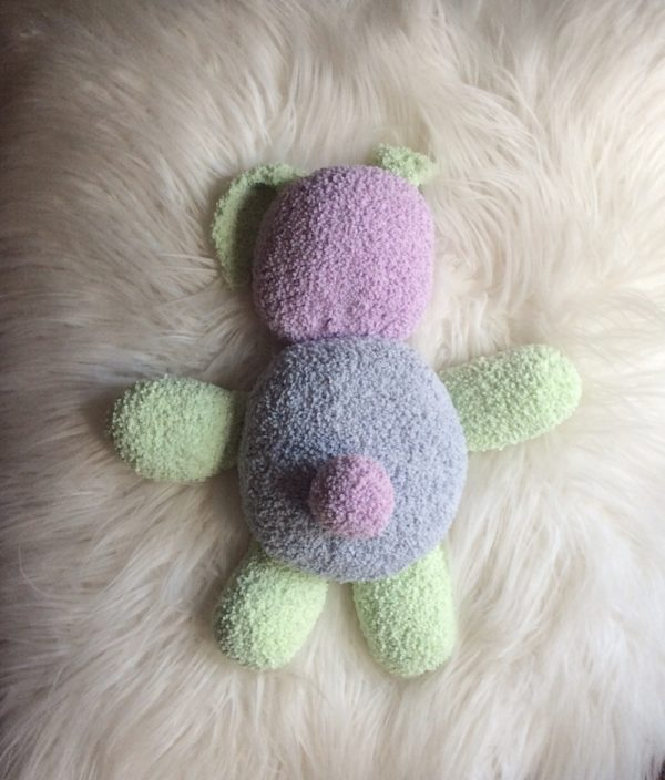 Bouncy Bouclé Bunny, free crochet pattern by Underground Crafter in Lion Brand Baby Soft Bouclé yarn, stuffed with Fairfield Poly-Fil Crafter's Choice Dry Polyester Packing Fiber Fill - bunny on faux fur background