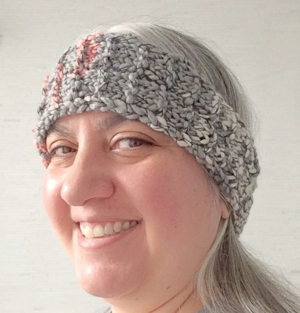 Garter Ridge Headband, free knitting pattern in Lion Brand Stitchbird yarn by Underground Crafter on smiling woman