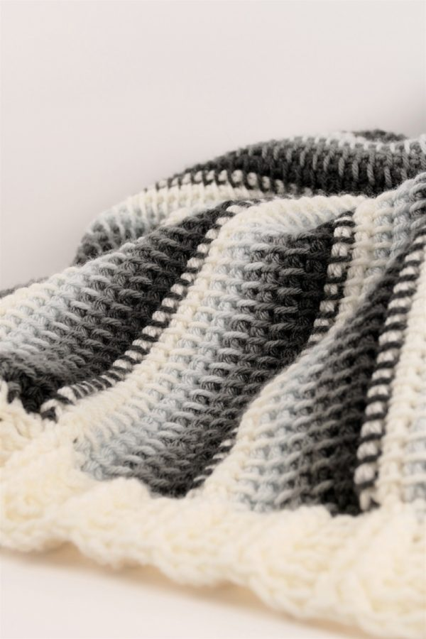 Free crochet pattern: Sweet Stratus Tunisian Baby Blanket free crochet pattern in Paintbox Yarns Simply Chunky yarn by Made with a Twist by Crochetpreneur for Underground Crafter