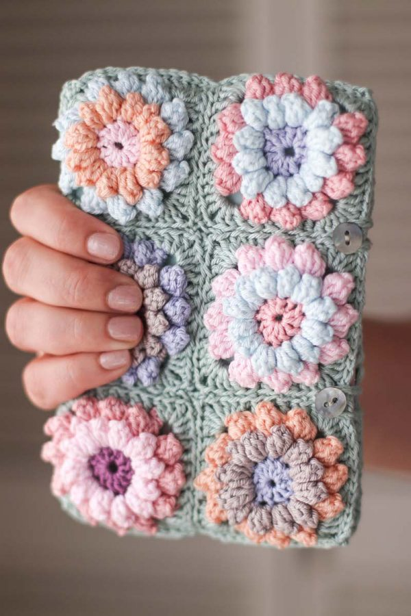 Flower Clutch, free crochet pattern by Thoresby Cottage for Underground Crafter - hand holding clutch