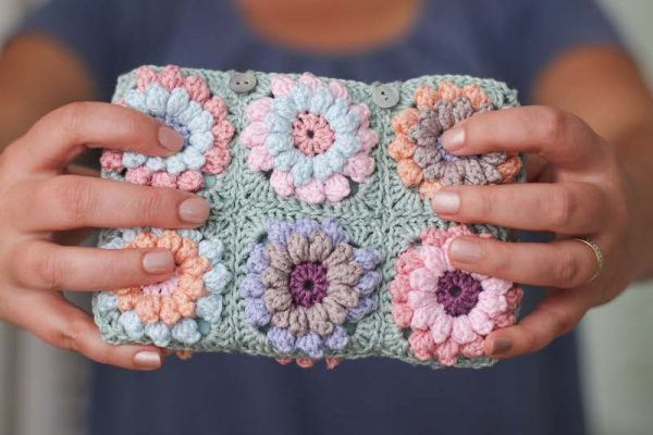 Flower Clutch, free crochet pattern by Thoresby Cottage for Underground Crafter - hands holding clutch