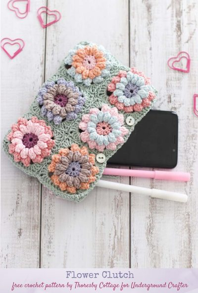 Flower Clutch, free crochet pattern by Thoresby Cottage for Underground Crafter - flatlay of clutch with phone