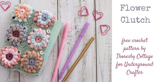 Flower Clutch, free crochet pattern by Thoresby Cottage for Underground Crafter - flatlay of clutch with pens