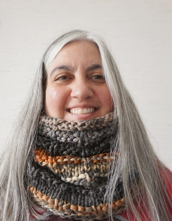 Free knitting pattern: Rustic Hooded Cowl in Lion Brand Mandala Thick & Quick yarn by Underground Crafter | smiling woman wearing textured, hooded cowl