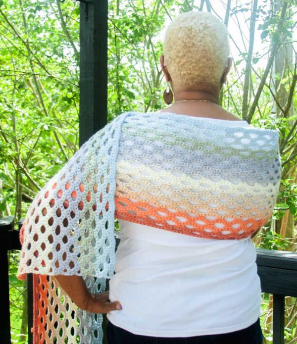 Free crochet pattern: Sweet Honeycomb Super Wrap in Paintbox Yarns Cotton Aran yarn by Stitch in Progress for Underground Crafter | model wearing lace shawl shown from behind against tree background