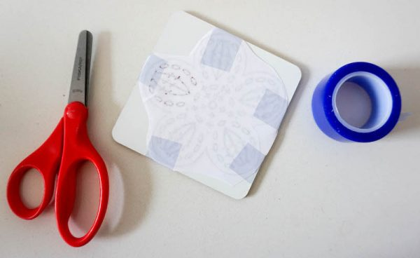 How To Make Granny Square Coasters with Crochet Coloring Pages and Cricut Infusible Ink by Underground Crafter - scissor, heat resistant tape, and coaster blank