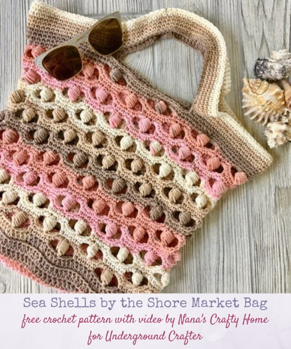 Sea Shells by the Shore Market Bag, free crochet pattern with video tutorial by Nana's Crafty Home for Underground Crafter | striped, lacy, and textured market bag flat lay on wood with sunglasses and sea shells