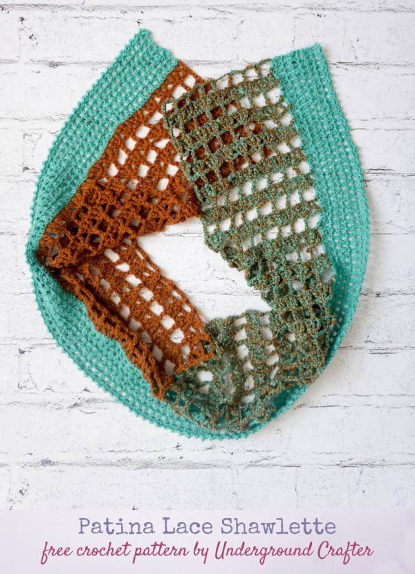 Patina Lace Shawlette, free #crochet pattern in Terra Fibres Handspun Merino Sport yarn by Underground Crafter | Color-blocked, crochet lace shawl on faux white brick background