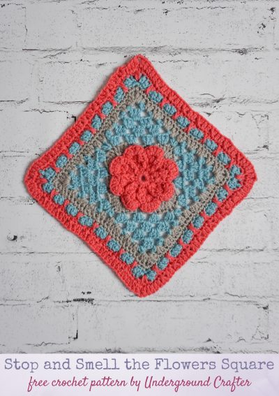 Stop and Smell the Flowers Square free crochet pattern by Underground Crafter - floral granny square on faux white brick background