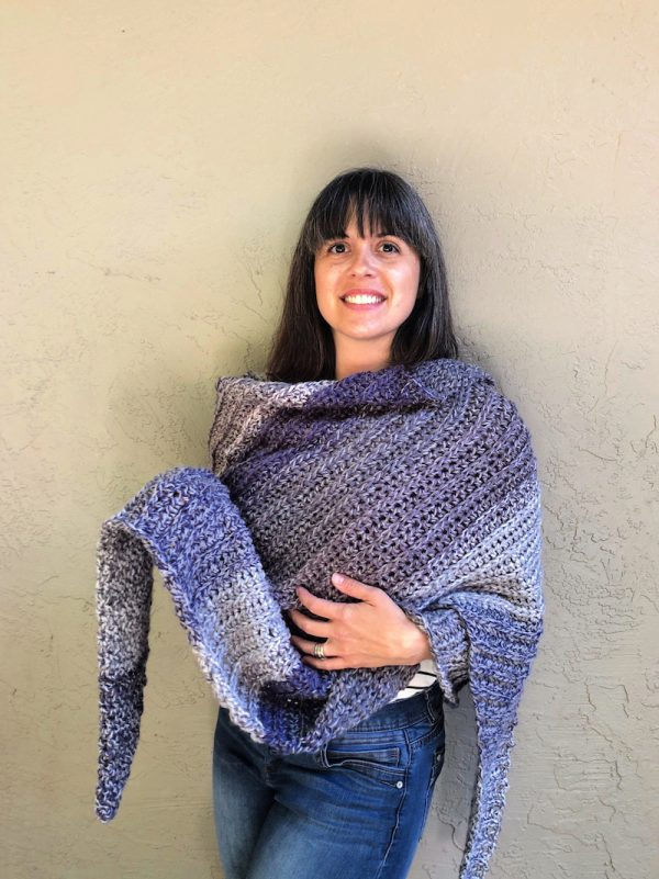 Storm Ridge Wrap, free crochet pattern in Red Heart Roll With It Tweed by ChristaCoDesign for Underground Crafter - smiling woman wearing crochet wrap
