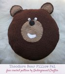 Theodore Bear Pillow Pal, free crochet pattern in Red Heart Super Saver yarn by Underground Crafter | Bear pillow pal on faux fur background