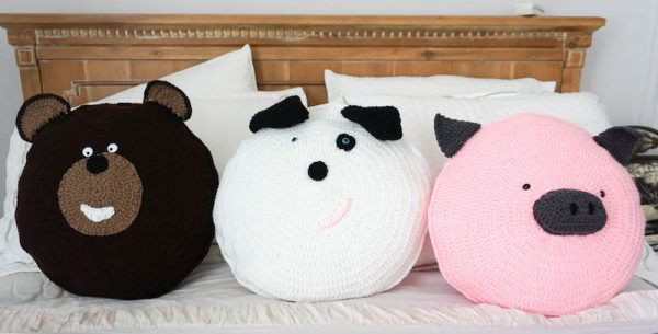 Spot Dog Pillow Pal, free crochet pattern by Underground Crafter - Theodore Bear, Spot Dog, and Wilbur Pig Pillow Pals on bed