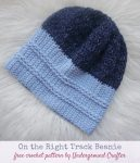 Free crochet pattern: On the Right Tracks Beanie in Lion Brand Jeans yarn by Underground Crafter - blue striped crochet hat on white, faux fur background