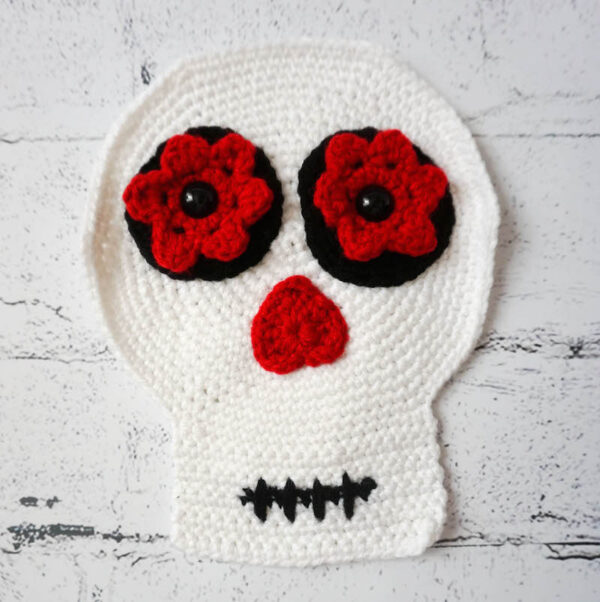 Crochet sugar skull face assembled - Simple Skull - Sugar Skull Reversible Softie free crochet pattern by Underground Crafter
