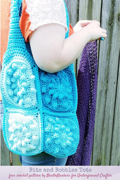 Bits and Bobbles Tote, free crochet pattern by NeedleKlankers for Underground Crafter (with video) - Textured crochet tote hanging on shoulder of person crocheting
