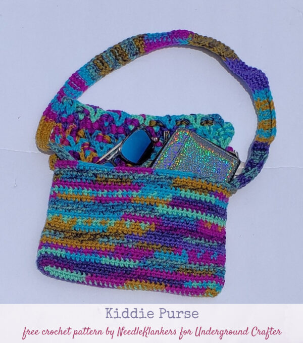 Kiddie Purse, free crochet pattern by Needle Klankers with video for Underground Crafter - child's multi-color purse flat lay
