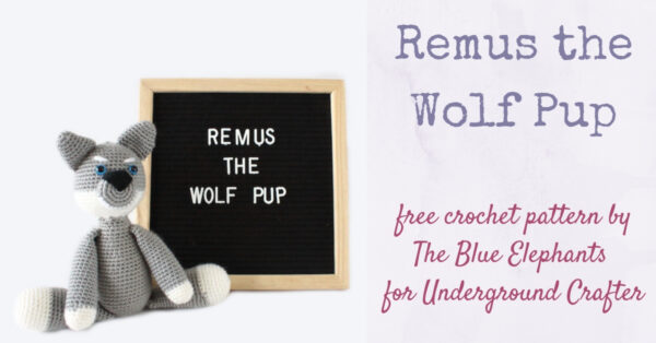 Remus the Wolf Pup free crochet amigurumi plushie by The Blue Elephants for Underground Crafter - crochet wolf plushie next to letter board with Remus the Wolf Pup written on it
