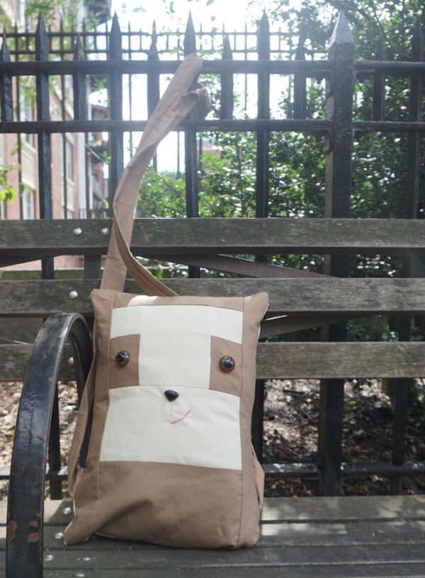 Sew a Sloth!/How To Add Safety Eyes to Fabric by Underground Crafter - boxy sewn sloth pillow sitting on park bench