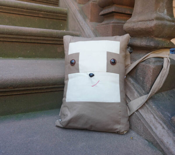Sew a Sloth!/How To Add Safety Eyes to Fabric by Underground Crafter - boxy sewn sloth pillow sitting on brownstone stoop