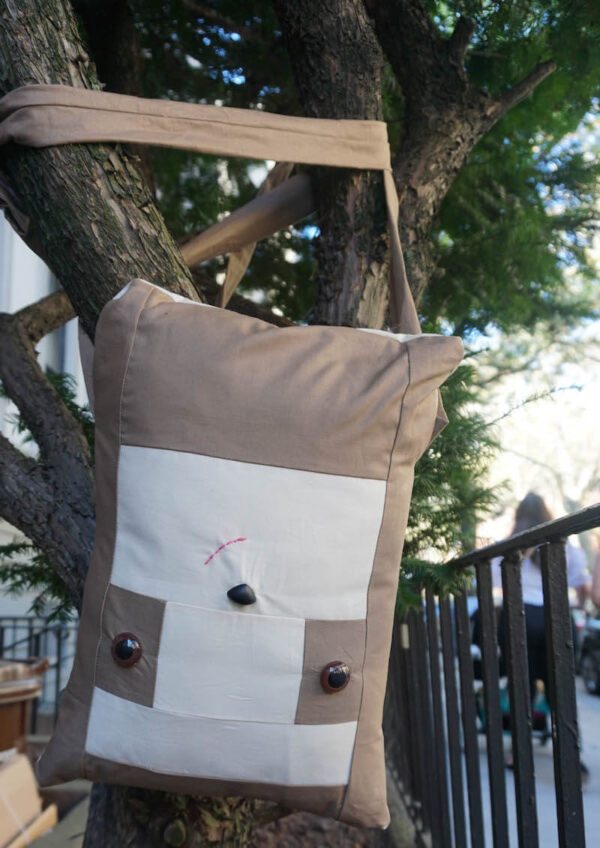 Sew a Sloth!/How To Add Safety Eyes to Fabric by Underground Crafter - boxy sewn sloth pillow hanging from tree