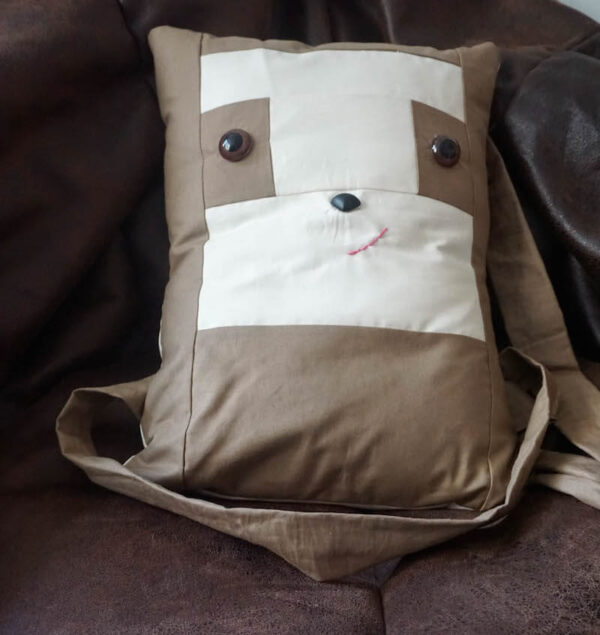 Sew a Sloth!/How To Add Safety Eyes to Fabric by Underground Crafter - boxy sewn sloth pillow on chair