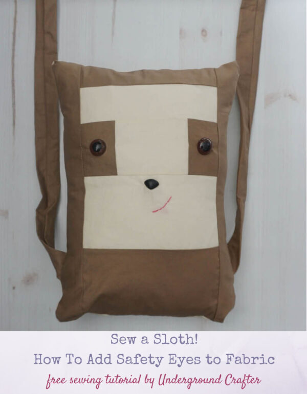 Sew a Sloth!/How To Add Safety Eyes to Fabric by Underground Crafter - boxy sewn sloth pillow on faux wood background