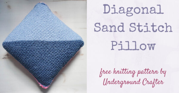 blue knit pillow against faux wood grain vinyl - Diagonal Sand Stitch Pillow free knitting pattern in Lion Brand Jeans and Crayola Cake yarn by Underground Crafter