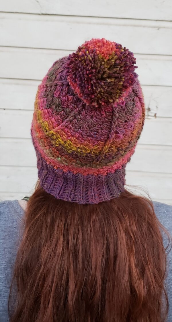 Free crochet pattern: Pumpkin Patch Beanie in Red Heart Roll With It Melange yarn by NeedleKlankers for Underground Crafter