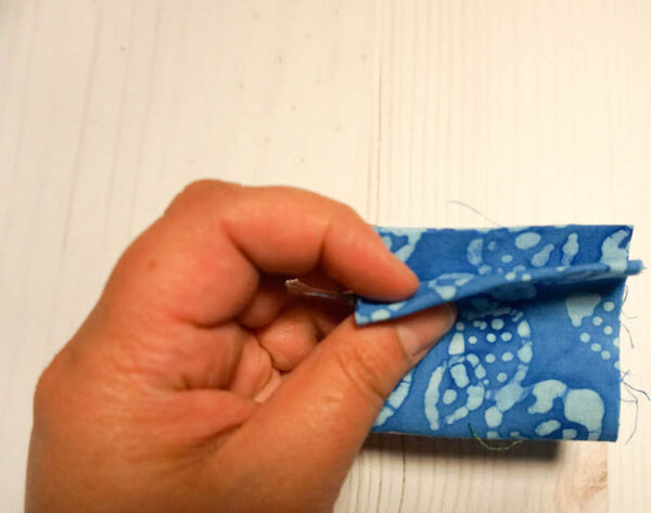 Handmade Pincushion and Pattern Weights Set with Cricut EasyPress Mini via Underground Crafter - folding fabric strip for pattern weight